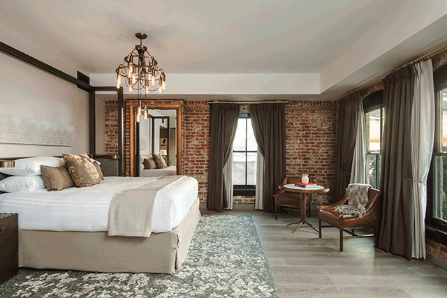 European Inspired Details And Exposed Brick Define A Guestroom At The Simeone Deary Design Group Crafted Charmant Hotel