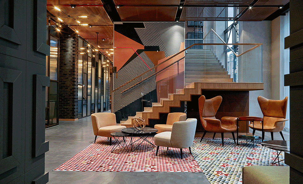 A Striking Geometric Mural In Black Gray And Salmon Hues By Seikon Welcomes Guests To Puro Gdansk Where London Firm DeSallesFlint Conceived Eclectic